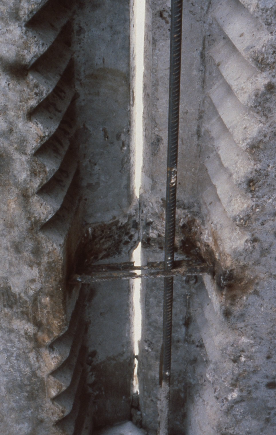 Exterior wall intersection of large-panel building with welded ties; shown before casting concrete was placed. Note serrated panel edges for shear transfer (Wyllie, 1989).