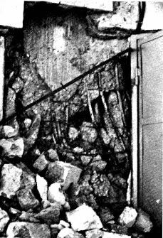 Crushed core wall at front of sixteen-story lift-slab building (Wyllie, 1989).