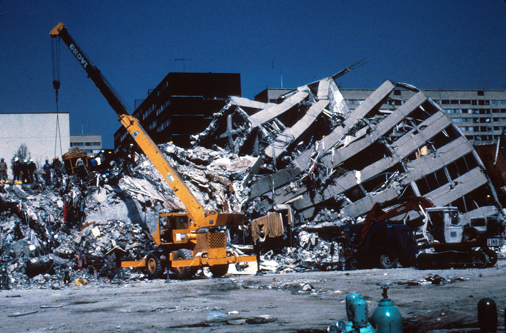 Collapsed northern wings of the building looking south (Taken from USGS Photographic Library, 1985)