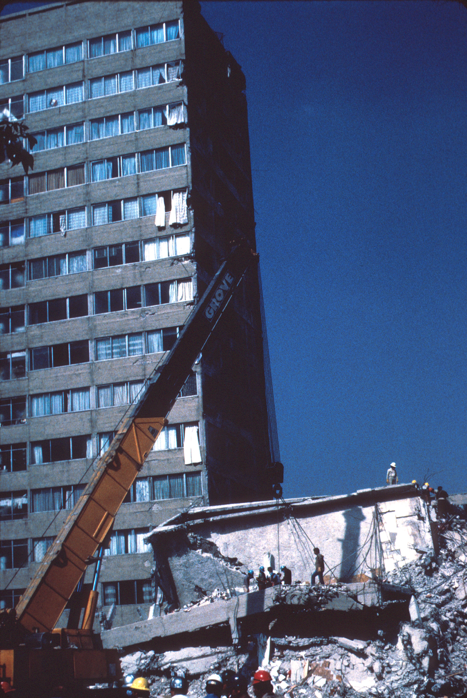 Collapsed middle wing of the building looking west (Taken from USGS Photographic Library, 1985)