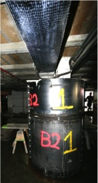 Basement girders wrapped with reinforced fiber polymer after the September 3, 2011 earthquake created a strong-beam weak-column mechanism and contributed to the extensive failure in basement columns. (Elwood, 2011)