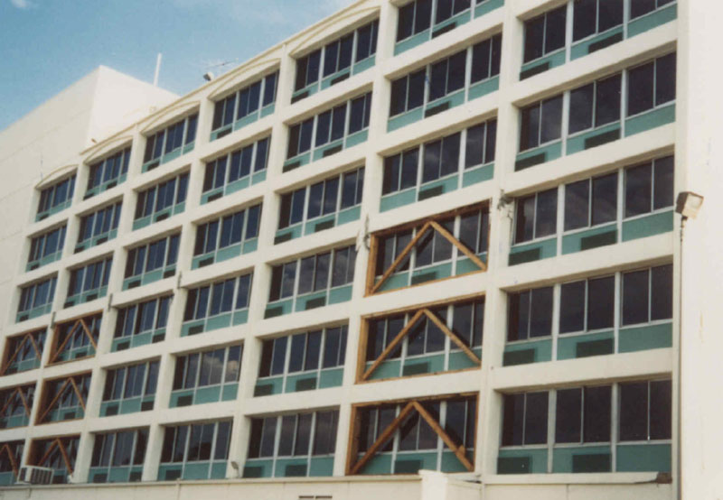 North elevation of the damaged building with temporary shoring in place. (Comartin et al., 2004)