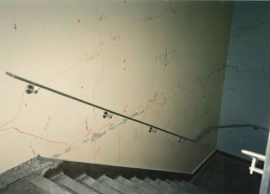 Sliding damage at east stair wall (Grid 15)